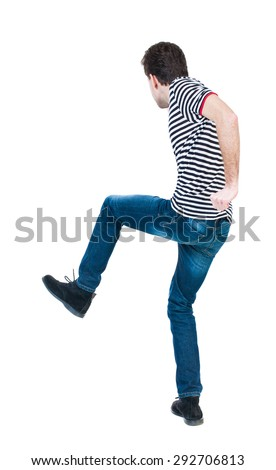back view skinny guy funny fights waving his arms and legs. Isolated over white background.Rear view people collection. backside view of person. Funny guy clumsily boxing. guy in striped shirt jumping - stock photo