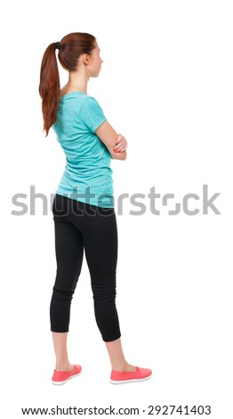 back view standing young beautiful woman. girl watching. Rear view people collection.  backside view person Isolated over white background. Sport girl stands with his arms crossed and looking to right - stock photo