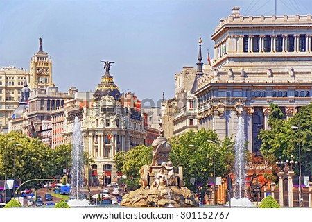 Back view to Cibeles fountain on square and Alcala street in Madrid, selective focus - stock photo