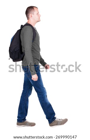 back view walking man with backpack.  brunette guy in motion. backside view of person.  Rear view people collection. Isolated over white background. young man goes to side rolling travel bag on wheels - stock photo