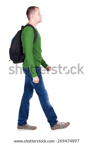 back view walking  man with backpack. brunette guy in motion. backside view person.  Rear view people collection. Isolated over white background. young man goes to side of a rolling travel bag - stock photo