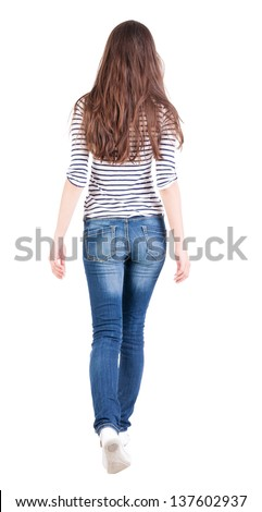 back view walking  woman. beautiful brunette girl in motion. backside view person.  Rear view people collection. Isolated over white background. girl in a striped black and white T-shirt steps forward - stock photo