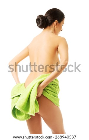 Back view woman wrapped in towel showing her bum. - stock photo