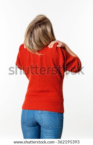 backache, lumbago, scoliosis health problems - young blond woman relaxing her shoulders and neck with self-massage and acupressure,white background - stock photo