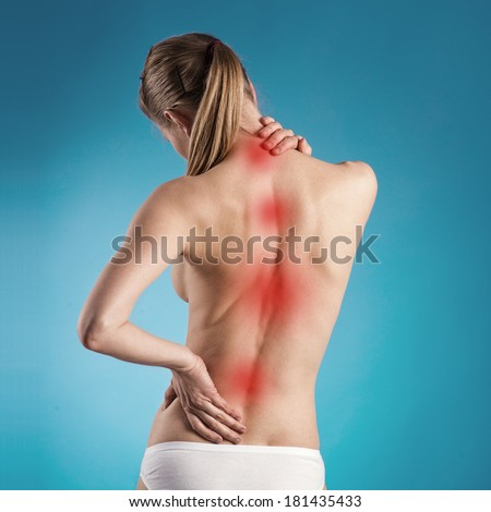 Backache. Young female with naked back having spine problem. Backbone Pain. - stock photo