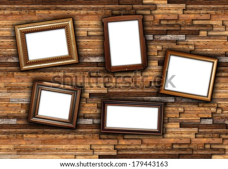 backdrop for your message with wooden frames on abstract wall - stock photo
