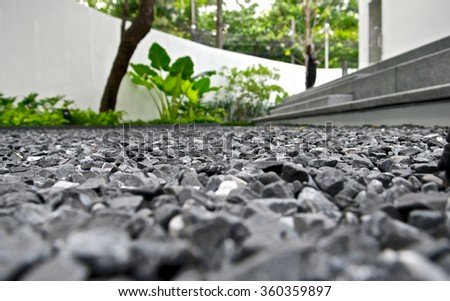 Backdrop pattern grey gravel granite texture ground view background for mix rock concrete in construction industrial. Small gray pebble on ground or floor. Vintage and retro. Ant view. Close up. - stock photo