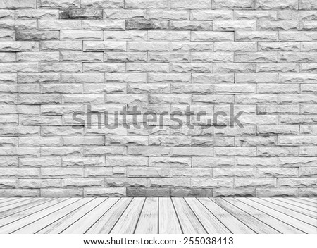 Backdrop sandstone brick wall and wood slabs arranged in perspective texture background. - stock photo