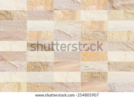 Backdrop white sandstone brick wall and wood slabs arranged in perspective texture background. - stock photo
