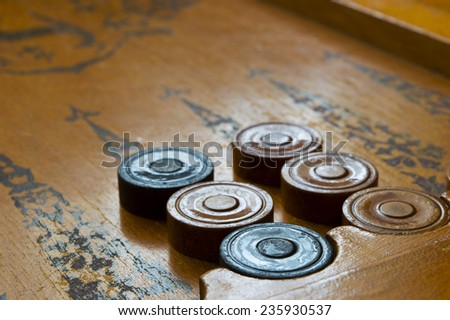 Backgammon game shot against the light - stock photo