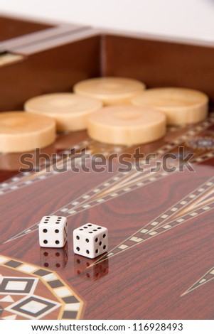 Backgammon table, chips and dices with double six. - stock photo