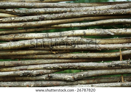 Background: a wooden wattle fence. - stock photo