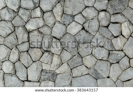background and texture of granite stone wall surface - stock photo