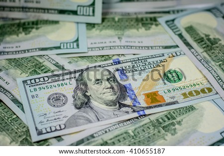 Background and texture of one hundred american dollar currency,money.Focus on eye of Franklin - stock photo