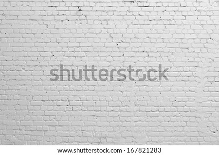 Background. Brick wall painted with white paint. - stock photo