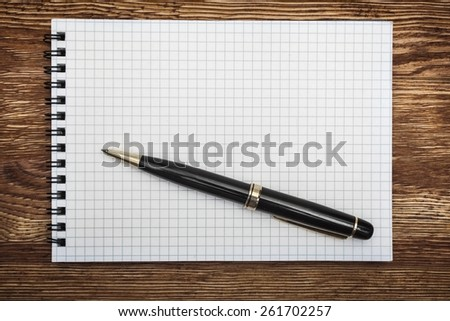 Background. close up opening note paper and pen on wood texture background with copy space - stock photo
