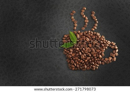 Background. Coffee beans with leaves isolated on white - stock photo