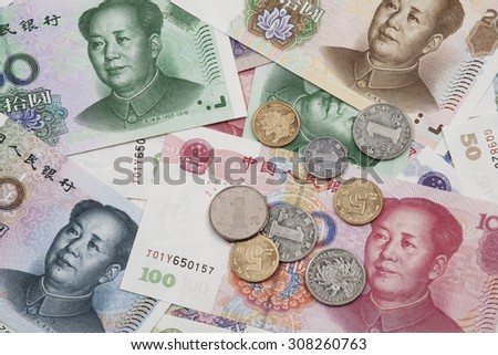 Background collage of Chinese Rmb bank notes  or Yuan and coins with Chairman Mao on the front of each bill - stock photo