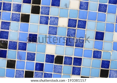 Background created with a blue tiled wall - stock photo