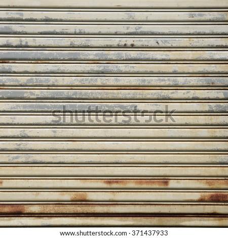 Background Detail of texture metal door Corrugated Iron  - stock photo