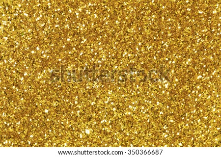 Background filled with shiny gold glitter. - stock photo