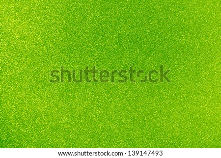 Background filled with shiny lime green glitter - stock photo