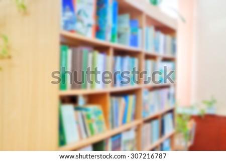 background for design : horizontal blurred library bookshelves - stock photo