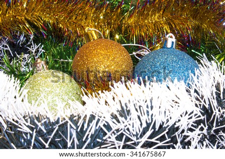 Background for New Year's and Christmas cards. Celebratory  holiday bright rainbow decorations for Christmas trees or pine - stock photo