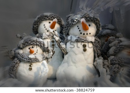 background for xmas card of three snowmen - stock photo