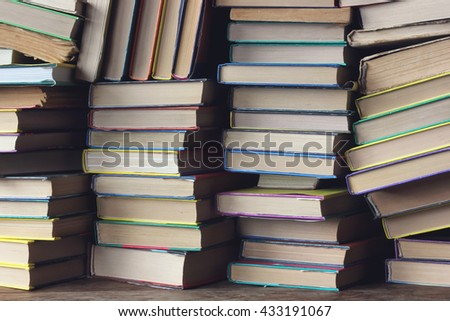 Background from books. The piles of books on the shelf closeup. Library. Back to school. - stock photo