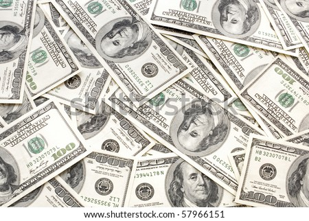 Background from considerable quantity of the scattered dollars - stock photo