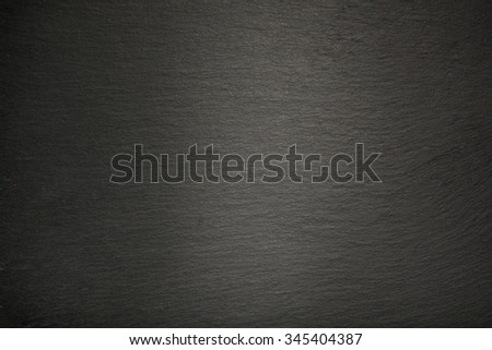 Background from dark slate rock, texture with spot light. - stock photo