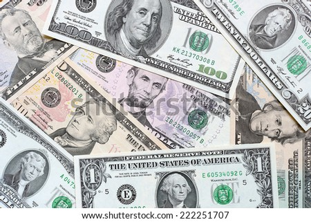Background from different banknotes of dollars close up. - stock photo