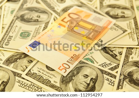 Background from dollar banknotes with focus on fifty euro - stock photo