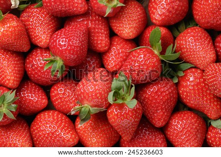 background from freshly harvested strawberries, directly above - stock photo