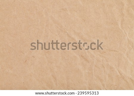 background from sheet of crumpled kraft paper close up - stock photo