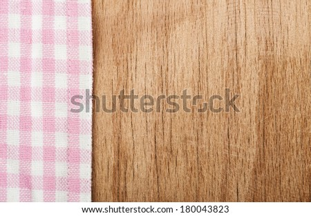 Background from tablecloth and wooden table - stock photo
