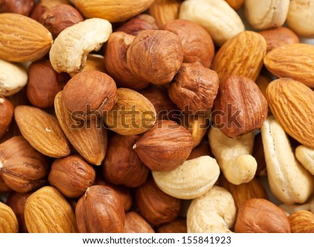 Background from various kinds of nuts (almond, hazelnut, cashew, Brazil nut) - stock photo