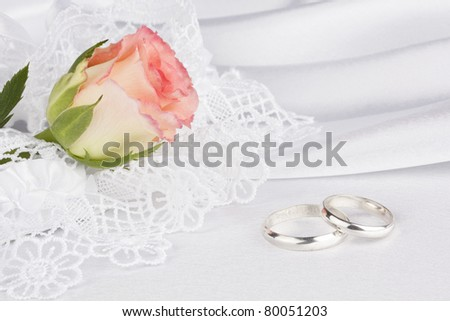 Background from white silk with a lace and rose - stock photo