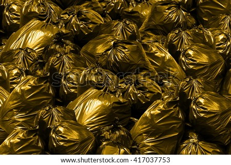 Background garbage dump Garbage bags with yellow and gold - stock photo