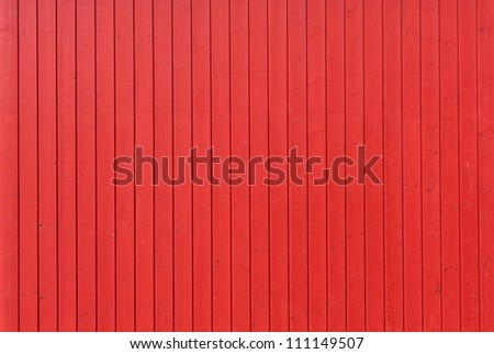 Background image of a wooden wall painted in bright red color - stock photo