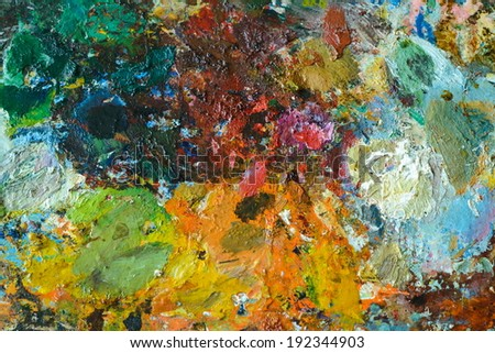 Background image of bright oil-paint palette closeup  - stock photo