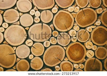 background image of round cut logs - stock photo