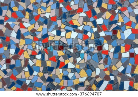 Background image with many assorted fragments of broken tiles - stock photo