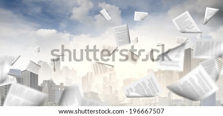 background image with papers flying in air - stock photo