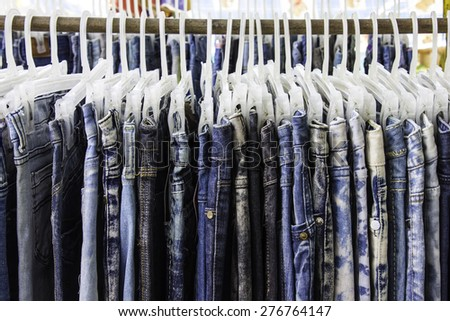 Background jeans hanging around. - stock photo