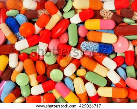 Background made from pills and capsules - stock photo