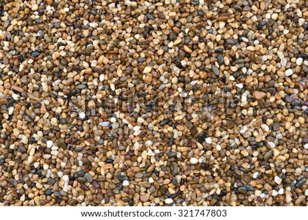 background made of a closeup of a pile of pebbles in raining day - stock photo