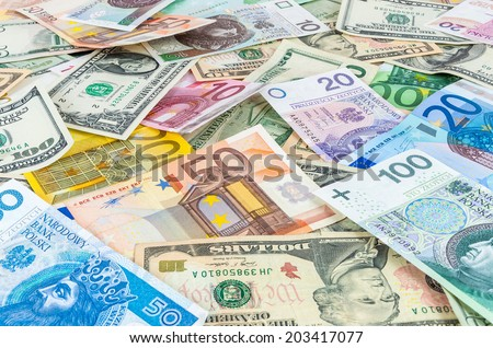 Background made of dollar, euro and polish zloty banknotes  - stock photo