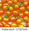 background made of yellow tomatoes - stock photo